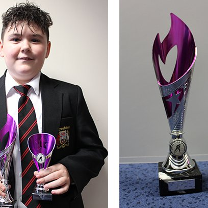 Harvey Collects Two Awards